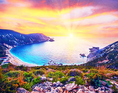 Fantastically fabulous mystical stunning magical landscape with the beach at sunset in Petani Beach, Kefalonia, Greece. Amazing places. Tourist Attractions.