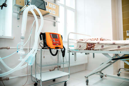 Plastic tubes for artificial lung ventilation apparatus and defibrillator for rescue of coronavirus patients in a modern hospital in the intensive care ward.