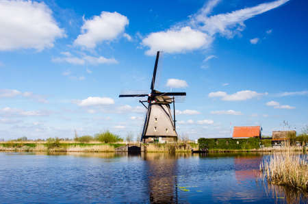 breathtaking beautiful inspirational landscape with windmills in Kinderdijk, Netherlands. Fascinating places, tourist attraction.