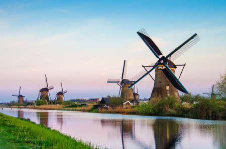 breathtaking beautiful inspirational landscape with windmills in Kinderdijk, Netherlands at sunset. Fascinating places, tourist attraction. Standard-Bild