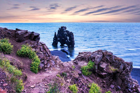 Beautiful dramatic landscape with extraordinary rock formation Hvitserkur on Vatnsnes peninsula in North-West Iceland. Exotic countries. Amazing places.