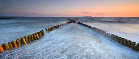 groynes: Coastal Sunset on the Baltic Sea, Wooden Groynes, Rugen Island, Germany