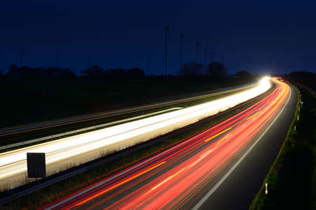 Stock photography Motorway at night, long exposure of headlights and taillights in blurred motion