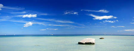 Beach with Huge Boulders, Blue Summer Sky with Clouds, Baltic Sea, Rugen Island, Germany Stock Photo