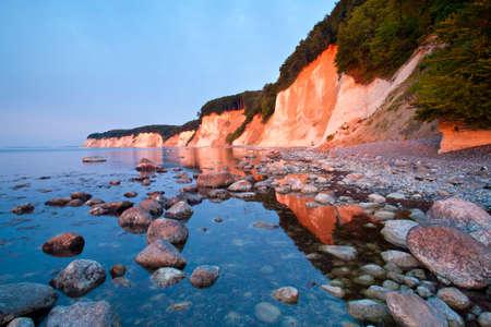 Coastal Sunrise, The Chalk Cliffs of Rugen Island in the Warm Light of the Rising Sun, Huge Boulders in the Baltic Sea, Jasmund National Park, Rugen Island, Ruegen, Germany
