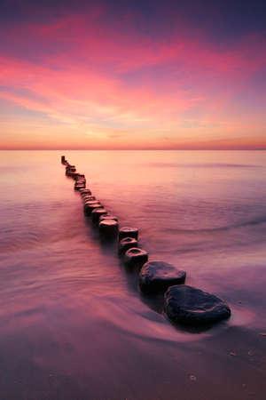Coastal Sunrise, Beach with Wooden Groyne, Usedom Island, Germany Stock fotó