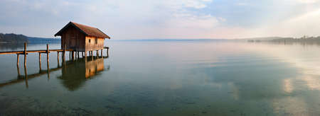 Fishing Hut at Sunset, Clouds Reflecting in the Water, Ammersee, Bavaria Editorial
