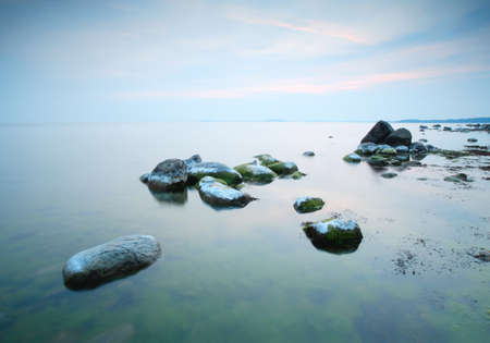 Sunset on the Baltic Sea, Huge Boulders at Calm Smooth Sea, Rugen Island, Germany