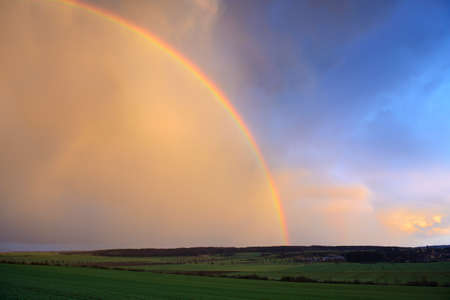 Dramatic Sky with Rainbow After Thunderstorm