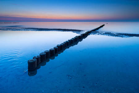 Coastal Sunset, Beach with Wooden Groyne, Darss peninsula, Germany Stock fotó