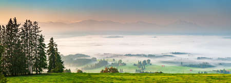 Panoramic view from Mt. Auerberg at Sunrise, Valley full of fog, the Alps behind, Bavaria, Germany Stock fotó