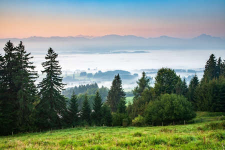 Scenic view from Mt. Auerberg at Sunrise over Valley. View from the Alps, Bavaria, Germany