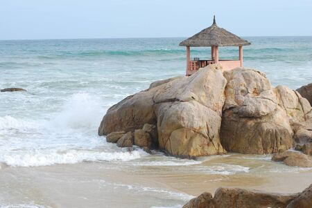ga: gazebo, sea, water, shore, restaurant, landscape, beautiful, fresh, travel, blue, wood, vacation, ocean, beach, sand, resort, nature, interior, beauty, summer, yellow, outdoor, nobody, stone, wave, raging, Vietnam, Phan Thiet, ke GA, seascape, space, cafe Stock Photo