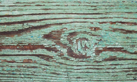 worn structure: Structure of the wooden surface as background.Covered with an old worn green paint. Stock Photo