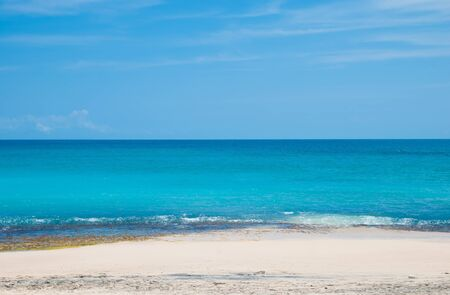 bali beach: The blue sea and blue sky on the beach Dreamland in Bali, Indonesia. Stock Photo