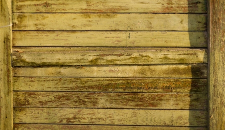 tarnished: Tarnished wooden plank walls of the old house as a background Stock Photo