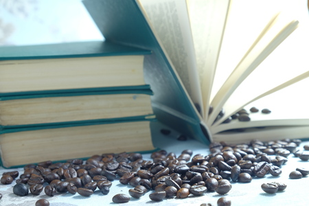 closed book: coffee beans in the background of a closed book