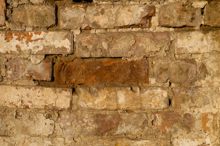 weathering: Old brick wall with traces of wear and weathering Stock Photo