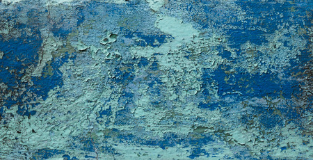 decrepit: Old weathered paint on a concrete wall. Blue abstract background. Stock Photo