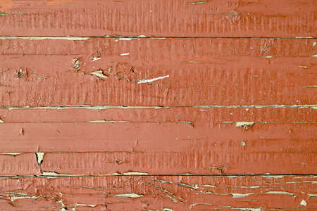 unevenly: Brown paint on a wooden boards use for background. Wood door closeup