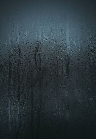 trickle down: Flowing down water drops on glass Stock Photo