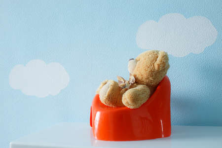 toy toilet bowl: Cute toy sitting on the potty