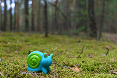 Toy snail on the moss