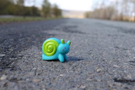 Toy snail on the road Foto de archivo