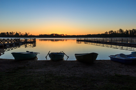 wharf: Wooden boats on the lake Stock Photo