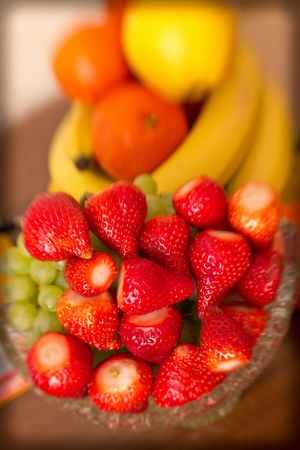 Assorted fruits in a crystal vase Stock Photo