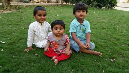 Babies sitting on the grass