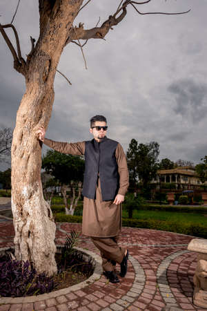 shalwar: Portrait of young Man in a traditional Pathan dress with modern haircut & modern look