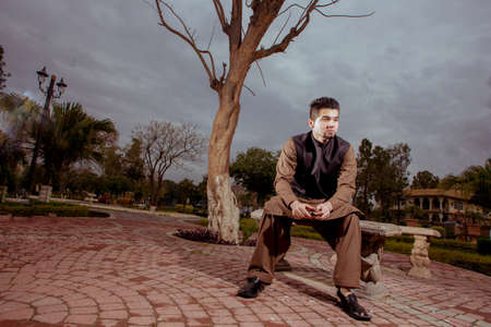 kameez: Portrait of young Man in a traditional Pathan dress with modern haircut & modern look