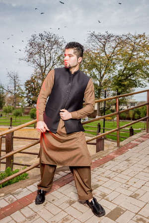 shalwar: Portrait of young Man in a traditional Pathan dress with modern haircut  modern look