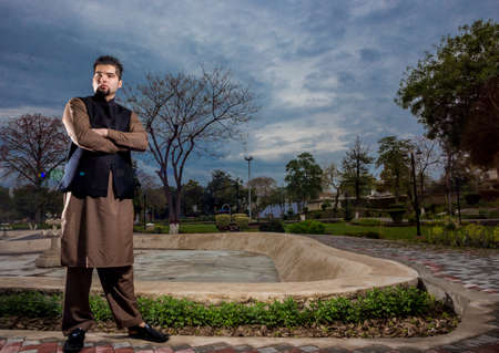 kameez: Portrait of young Man in a traditional Pathan dress with modern haircut  modern look