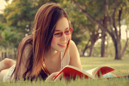 Lovely Girl Reading Book at Parks Stock fotó