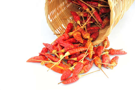 admixture: Red Peppers in Bamboo Basket and White Background Stock Photo