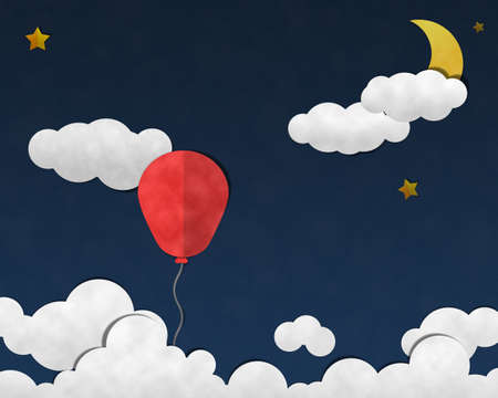 Paper Cut and Past, Balloon in Night Sky With Cloudy Background photo
