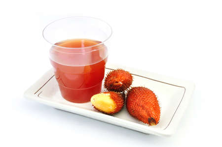 salak: Red Salak and Juice on White Background Stock Photo
