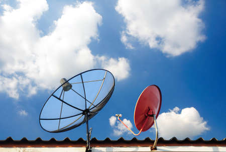 sattelite: satellite dishes on a house roof Stock Photo