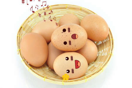 Eggs on Basket Isolated And White Background photo