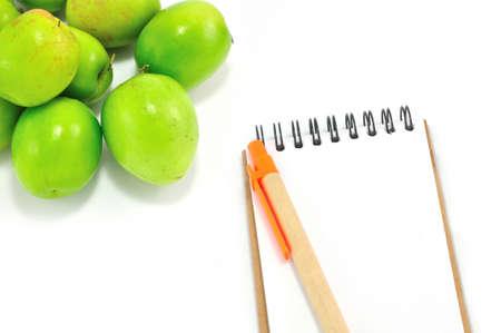 Notepad and Monkey friut  Isolated on White Background