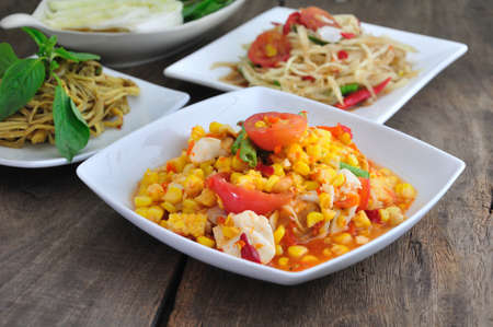 somtum: Spicy Thai Food on DIsh and Wooden background.