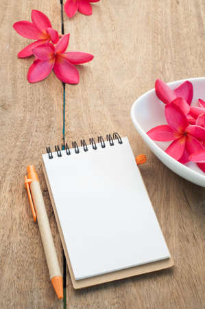 wooden floors: Blank Notepad paper on Wooden floors and Red Plumeria Flower.