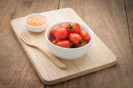 wooden floors: Small red tomato on wooden floors. Vegetarian Food. Stock Photo