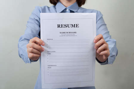 blue shirt: working woman in blue shirt displaying resume information. business concept.