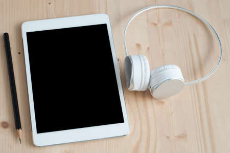 earphone: Office desk with Tablet and Earphone. Business concept background.