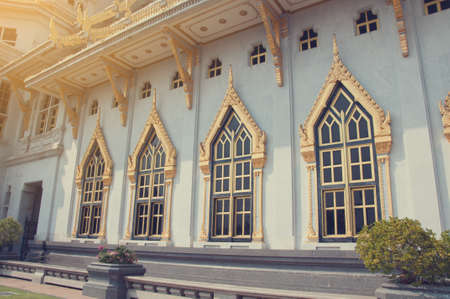 seep: Gold historic window at temple, Location in public area. Stock Photo