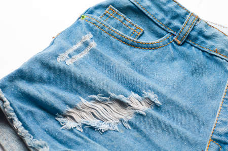 Womens Blue jeans shorts on white background.