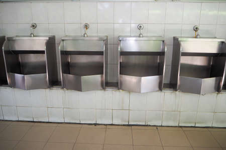 urinal: Urinal at public filling station in Thailand.